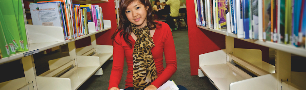 Student, Carene Lim from Malaysia, sitting in the library